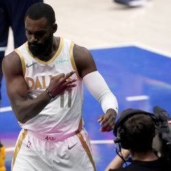 Dallas Mavericks forward Tim Hardaway Jr. (11) gestures three to the broadcast camera after being fouled on a basket by the Utah Jazz in the second half of an NBA basketball game in Dallas, Monday April 5, 2021.