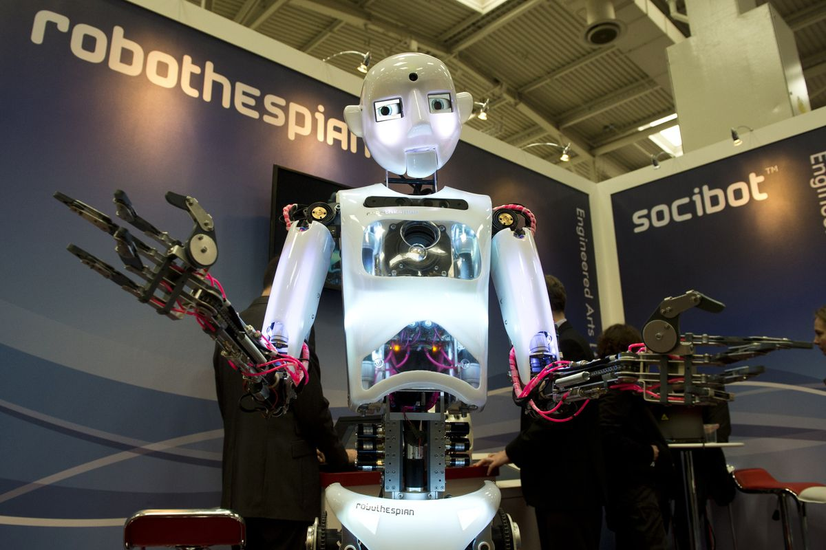 Robots, like this life-size, humanoid robot from the CeBIT computer technology trade fair, have gotten pretty advanced. But can robo-graders effectively evaluate humans' writing?