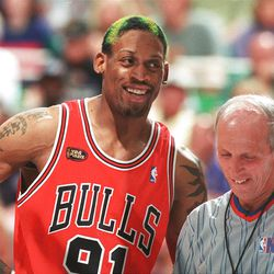 Dennis Rodman and a referee share a laugh during Game 6 of the NBA Finals at the Delta Center, June 14, 1998.