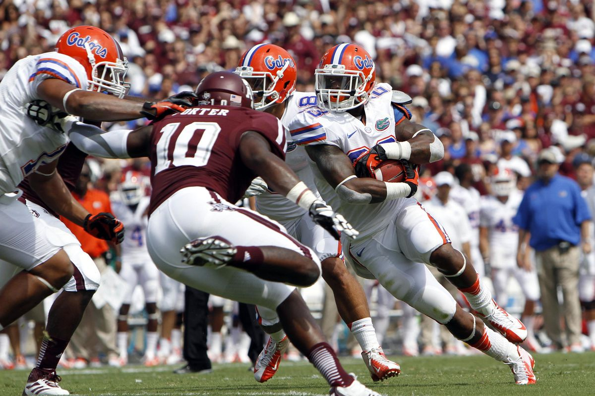 Sep 8, 2012; College Station, TX, USA; Florida Gators running back Mike Gillislee (23) runs the ball for a touchdown against the Texas A&M Aggies in the first quarter at Kyle Field. Mandatory Credit: Brett Davis-US PRESSWIRE