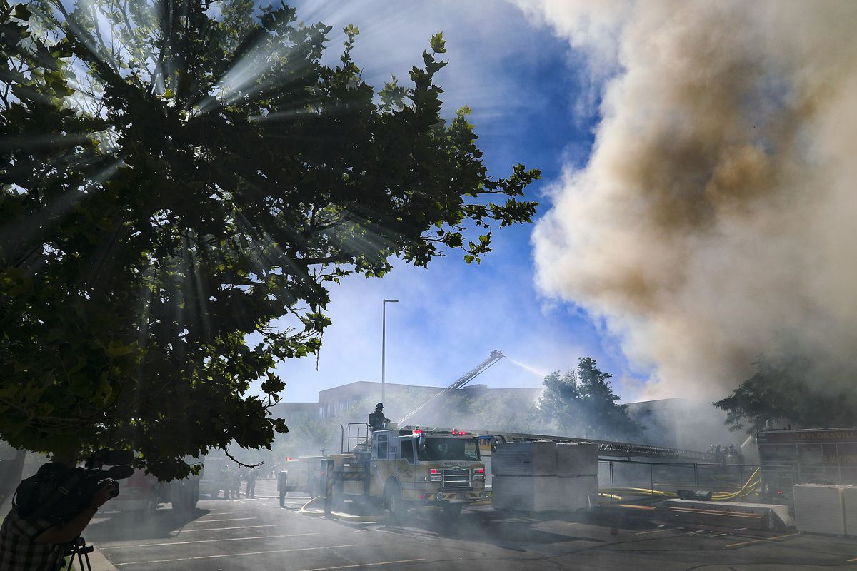 Firefighters battle a fire in the Applied Technology Building, which is under construction, at Salt Lake Community College at 4600 S. Redwood Road in Taylorsville on Monday, June 22, 2020.
