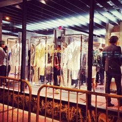 Encased metallic suits seduce 9th Street window-shoppers.