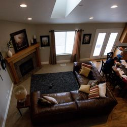 """The Kirby family gathers for a gospel study at home using """"Come, Follow Me — For Individuals and Families: Book of Mormon 2020,"""" a manual for The Church of Jesus Christ of Latter-day Saints, in Lehi on Sunday, March 15, 2020. The church temporarily canceled all meetings and activities worldwide to limit public gatherings in response to the coronavirus pandemic."""
