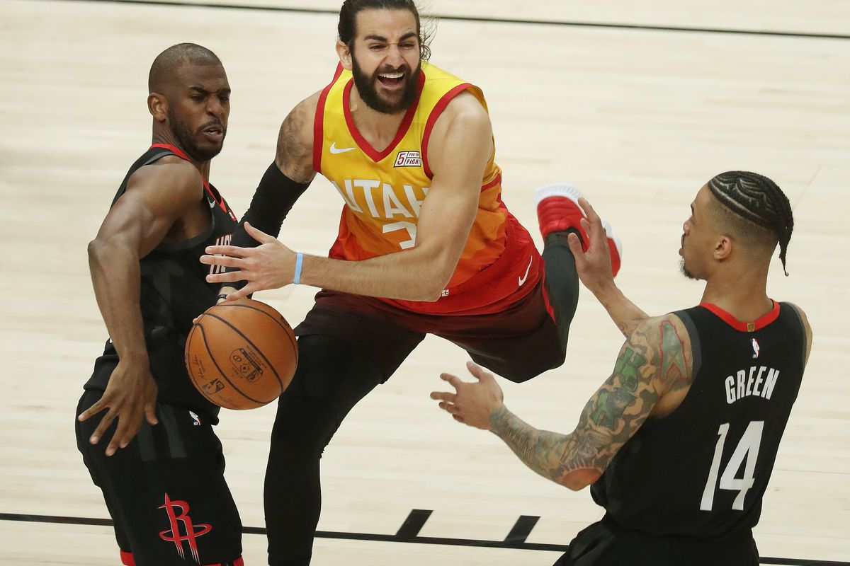 Utah Jazz guard Ricky Rubio (3) is gfouled by Houston Rockets guard Chris Paul (3) during NBA playoffs in Salt Lake City on Saturday, April 20, 2019.