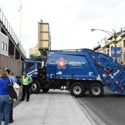 5:15 p.m. Police blocking off the sidewalk, as the replacement garbage truck maneuvers into position -