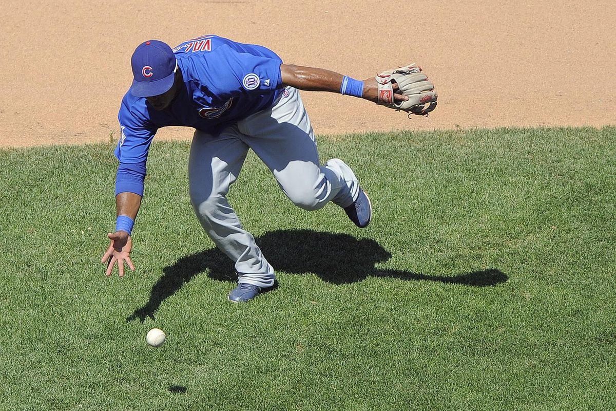 St. Louis, MO. USA; Chicago Cubs third baseman Luis Valbuena charges a ground ball against the St. Louis Cardinals at Busch Stadium. Credit: Jeff Curry-US PRESSWIRE