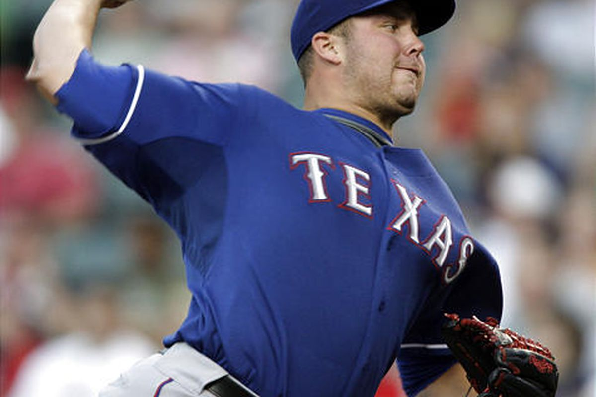 Texas Rangers' Tommy Hunter pitches against the Cleveland Indians.
