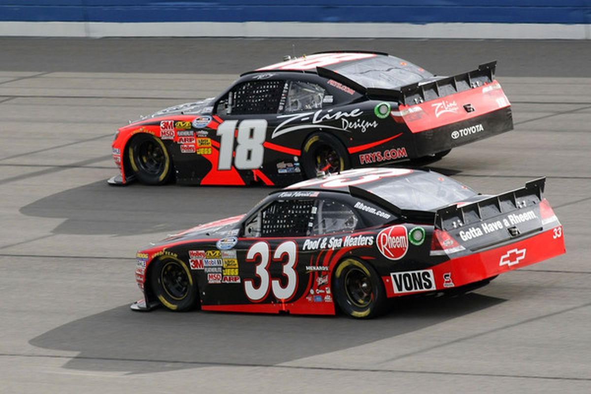 Kyle Busch (18) leads Kevin Harvick during the NASCAR Nationwide Series Royal Purple 300 at Auto Club Speedway.