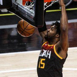 Utah Jazz forward Derrick Favors (15) dunks the ball as the Utah Jazz and the Toronto Raptors play an NBA basketball game at Vivint Smart Home Arena in Salt Lake City on Saturday, May 1, 2021.