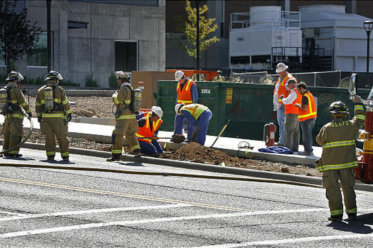Firefighters and gas company employees work on a gas leak at about 1550 East on 100 South Monday on the University of Utah campus. Salt Lake City Fire Department spokesman Scott Freitag said construction activity caused the leak. The fire department evacu