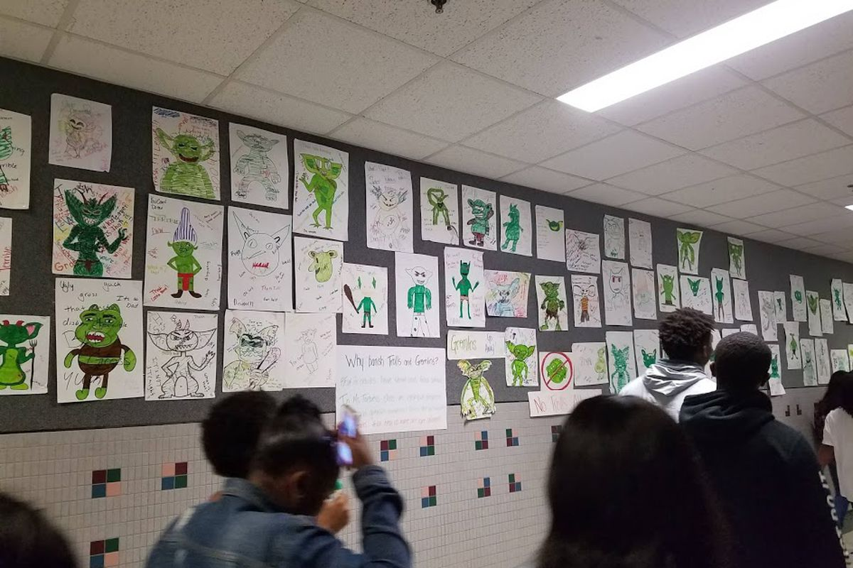 """""""No trolls allowed."""" Drawings from Indianapolis art teacher Kate Toebes' class hang in the hallways at Lawrence Central High School."""