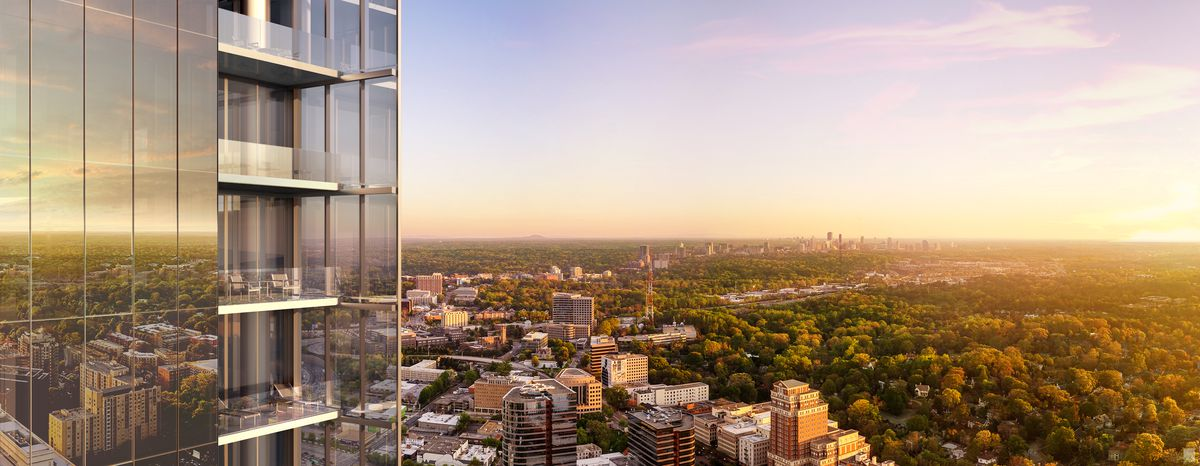 The Buckhead skyline at sunset, with the glass building at the edge of frame.