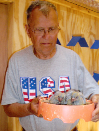 Tony Gacs and two of his racing pigeons in a nesting bowl. | Family photo