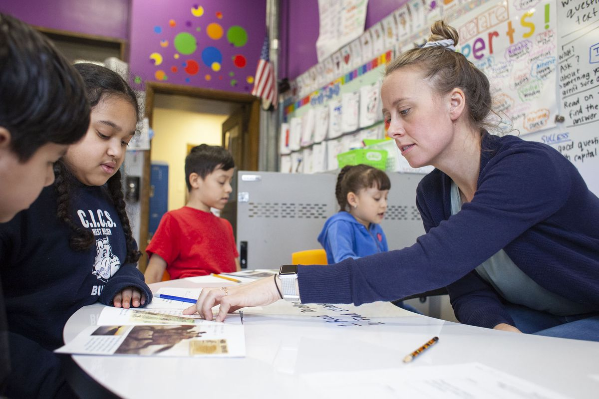 Teacher Kathy McInerney guides students during a small group lesson during class at CICS West Belden. The Chicago charter school employs the personalized learning method for its K-8 students. The school is part of the Chicago International Charter School network, and is managed by Distinctive Schools,.