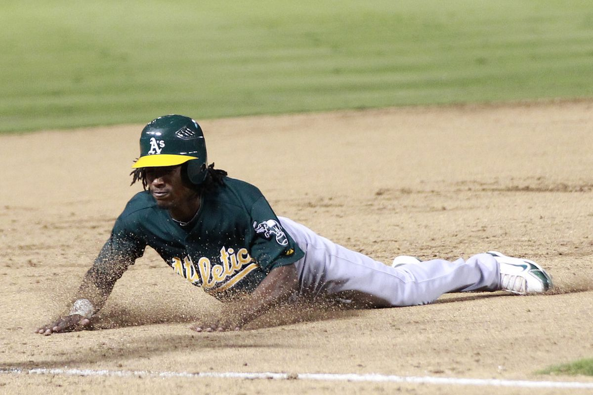 ARLINGTON, TX - JULY 7: Jemile Weeks #19 of the Oakland Athletics slides safely into third base against the Texas Rangers at Rangers Ballpark in Arlington on July 7, 2011 in Arlington, Texas. (Photo by Rick Yeatts/Getty Images)
