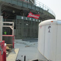 3:07 p.m. Equipment parked outside the main bleacher gate, blocking my view -