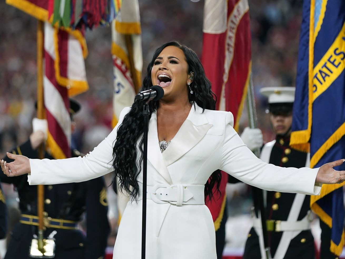 Demi Lovato performs the national anthem before the NFL Super Bowl 54 football game between the San Francisco 49ers and the Kansas City Chiefs in 2020.