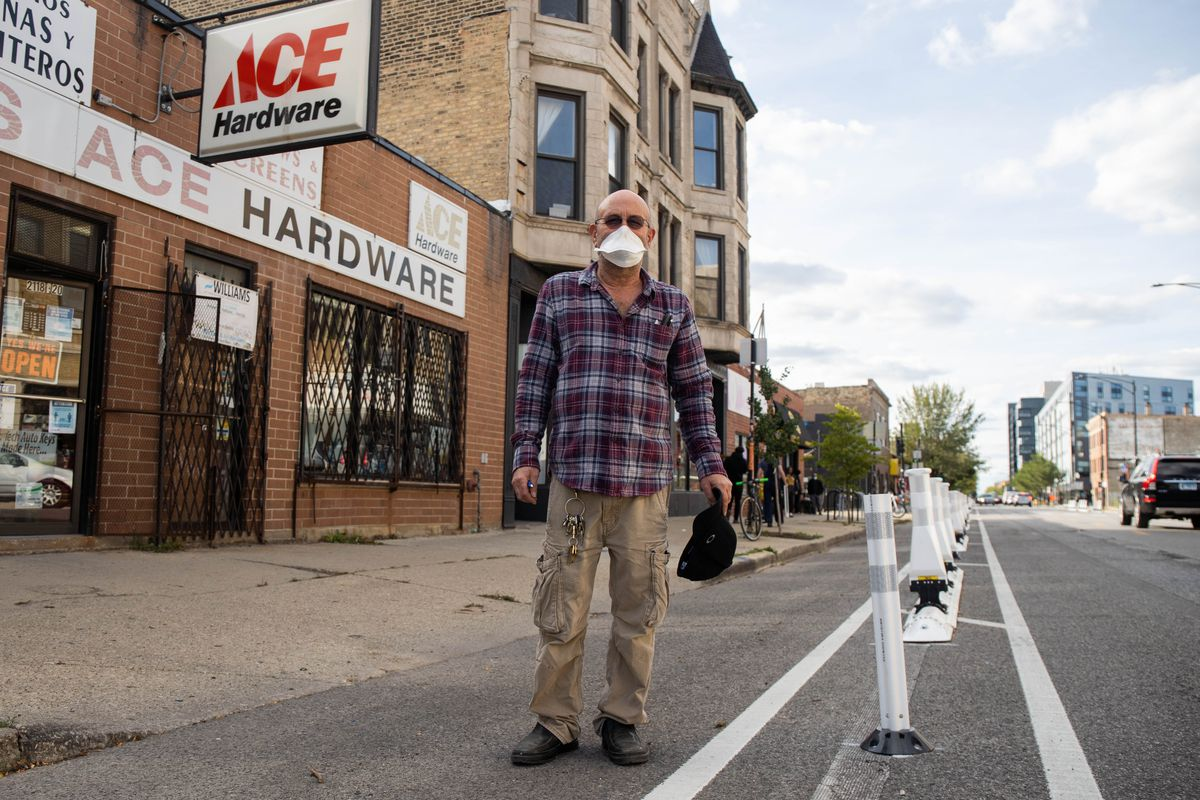 Alan Gillman, owner of Ace Hardware in Logan Square, poses for a portrait Friday afternoon, Oct. 2, 2020. Gillman is opposed to the new protected bike lanes along North Milwaukee Avenue and said it has caused a decline in customers because they have no place to park.