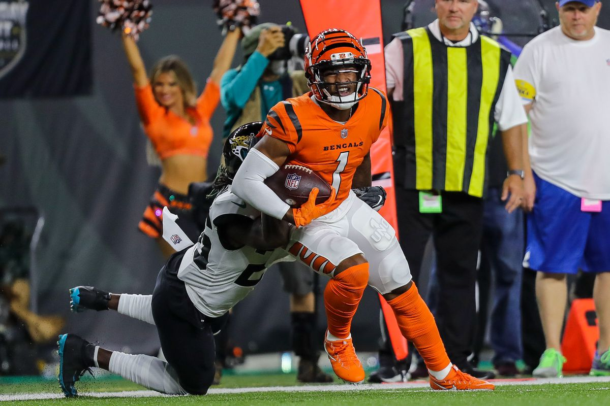 Jacksonville Jaguars cornerback Shaquill Griffin (26) brings down Cincinnati Bengals wide receiver Ja'Marr Chase (1) in the first half at Paul Brown Stadium.