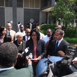 Frances Wright, center, reads a statement at a news conference on Tuesday, July 5, 2011 in Memphis, Tenn. She addressed reporters while surrounded by relatives after a Memphis gun dealer was sentenced to life in prison for killing her husband, code inspector Mickey Wright, in 2001.