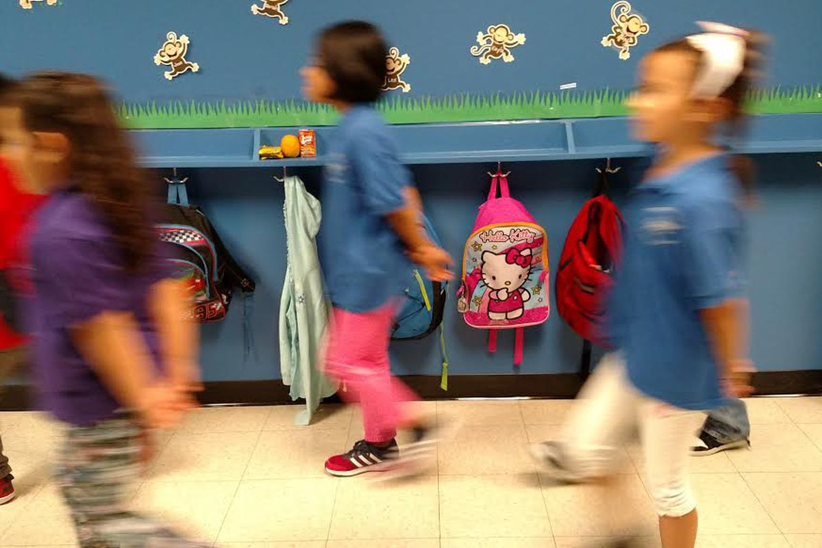 In place of tall olive green lockers at Trevista at Horace Mann: hooks and shelves that 4-year-olds can reach.