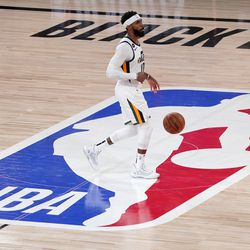 Utah Jazz's Mike Conley (10) advances the ball up court against the Denver Nuggets during the second half an NBA first round playoff basketball game, Tuesday, Sept. 1, 2020, in Lake Buena Vista, Fla.
