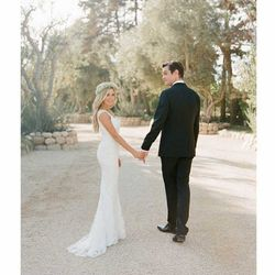 On September 8th, 2014, Ashley Tisdale, of High School Musical fame, tied the knot with Christopher French in a Monique Lhuillier dress and flower crown.