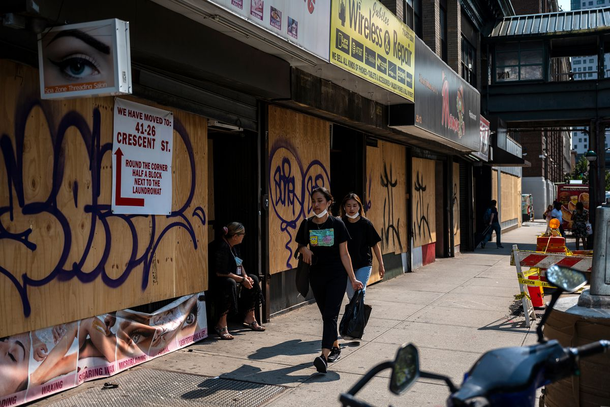 Boarded up storefronts line a block near Queens Plaza, Sept. 14, 2021.