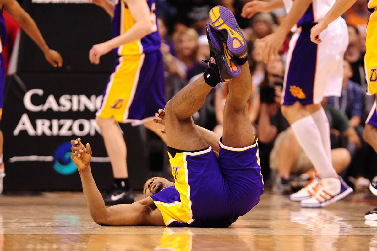 Apr. 7, 2012; Phoenix, AZ, USA; Los Angeles Lakers forward (15) Metta World Peace falls to the ground against the Phoenix Suns in the first half at the US Airways Center. Mandatory Credit: Mark J. Rebilas-US PRESSWIRE