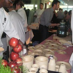 Plating at The Source's table.