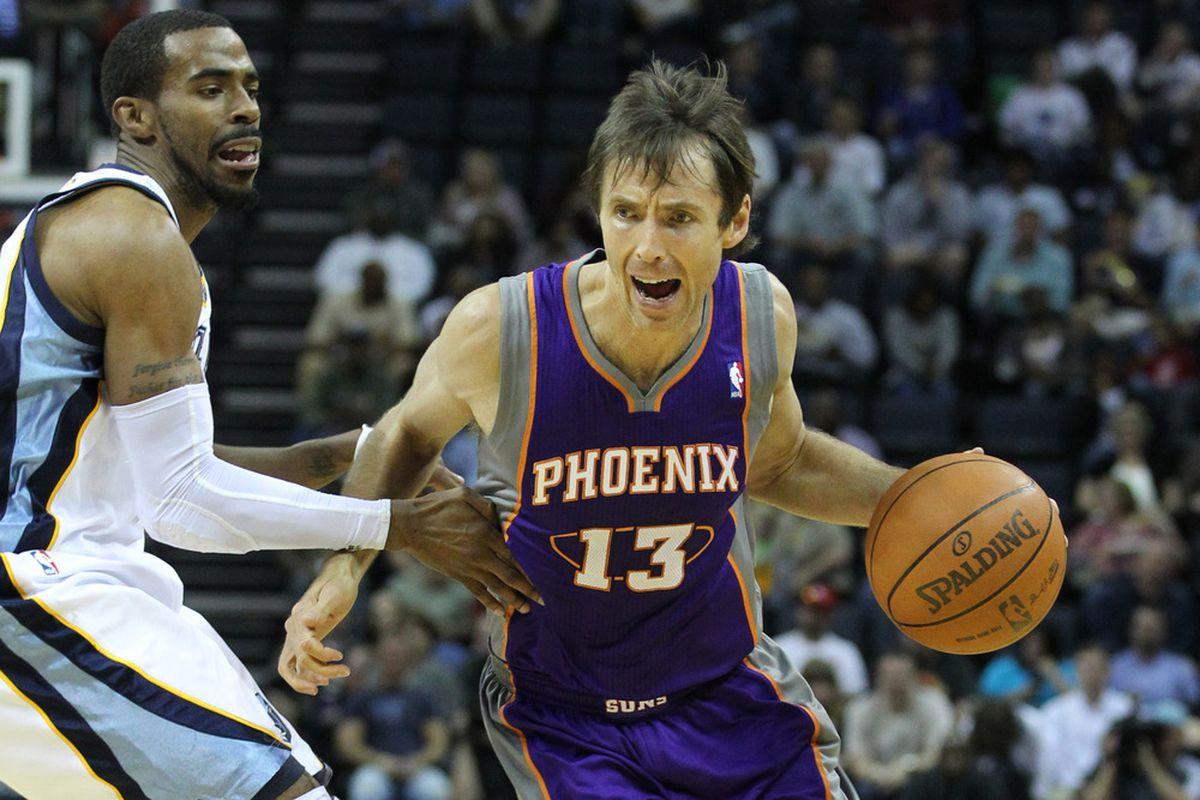 Apr 11, 2012; Memphis, TN, USA; Phoenix Suns guard Steve Nash (13) drives past Memphis Grizzlies guard Mike Conley (11) at the FedEx Forum.  Mandatory Credit: Nelson Chenault-US PRESSWIRE