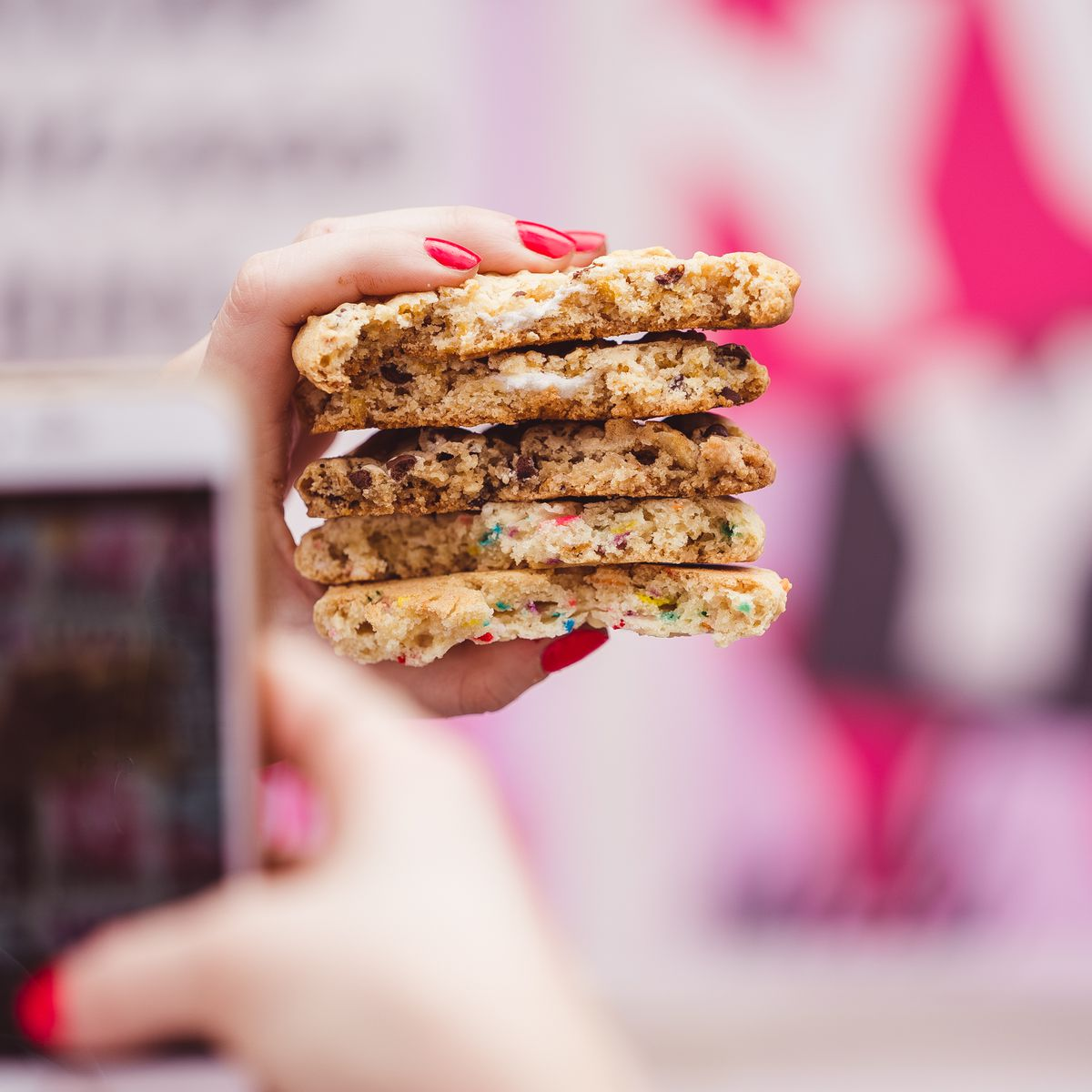 A photo of a photo being taken of a stack of cookies