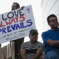Drew Reese holds a sign during a same sex marriage celebration at Library Square in Salt Lake City, Monday, Oct. 6, 2014.