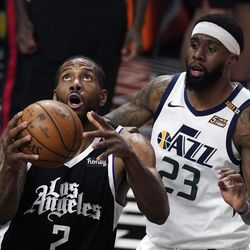 Los Angeles Clippers forward Kawhi Leonard, left, shoots as Utah Jazz forward Royce O'Neale defends during the second half of Game 3 of a second-round NBA basketball playoff series Saturday, June 12, 2021, in Los Angeles.