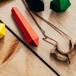 """<b>Metalepsis</b> The W Neclace, <a href=""""http://www.internationalplayground.com/women/accessories/jewelry/metalepsis-the-w-necklace.html""""> $110</a>"""