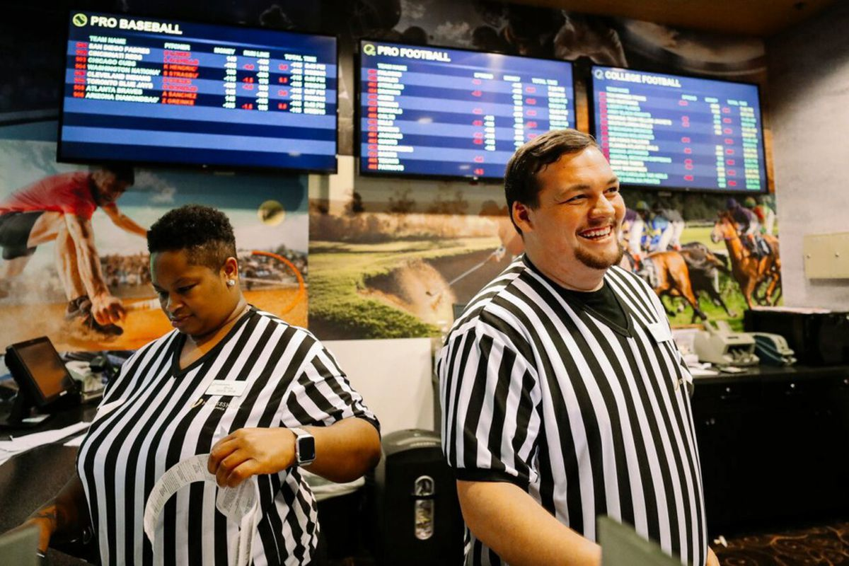 """Erica Shirley (left) and Graham Lowing became employees at Horseshoe Casino to work in its sports betting lounge after Mississippi joined Nevada, Delaware, New Jersey and West Virginia in making sports betting legal in the state. On Dec. 14, Tennessee Attorney General Herbert Slatery issued an opinion stating the Tennessee General Assembly may legalize sports betting without a constitutional amendment as long as the sport is based on skill and not predominantly on """"chance."""" (Houston Cofield/Dail"""