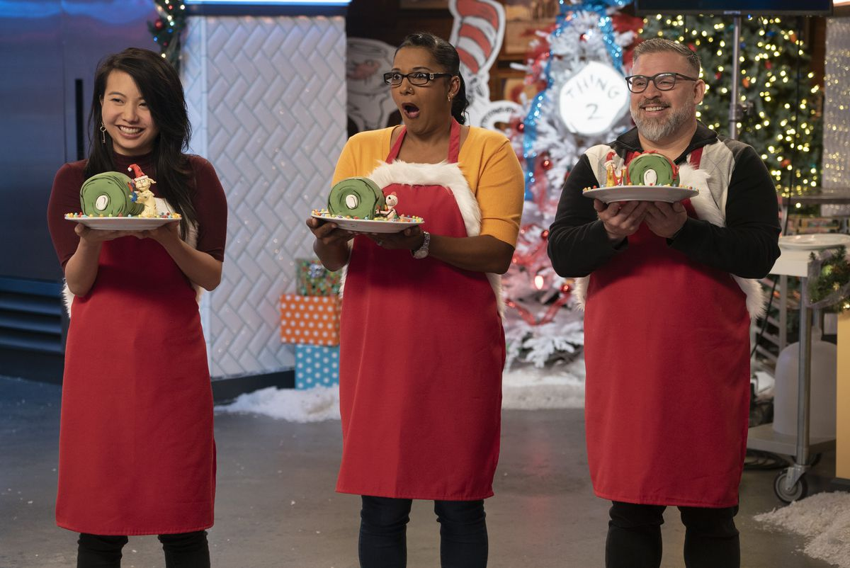 three contestants on nailed it, all holding yule logs in various states of despair