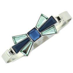 "<b>BCBGeneration</b> Bow Bracelet, <a href=""http://www1.macys.com/shop/product/bcbgeneration-bracelet-silver-tone-faceted-blue-stone-bow-bracelet?ID=745001&CategoryID=61902#fn=sp%3D1%26spc%3D95%26ruleId%3D25%26slotId%3D39"">$25</a> at Macy's"