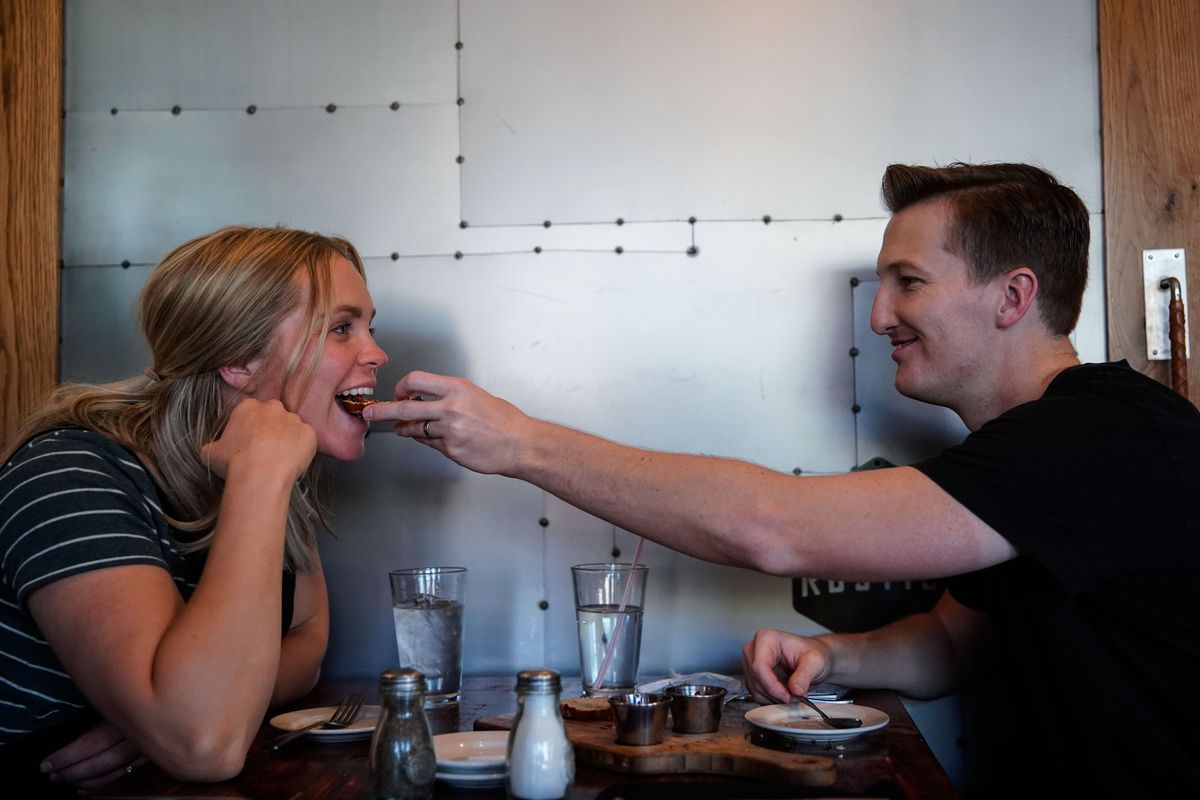 Brookston Jeppson feeds his wife, Haley, during a date night at a restaurant in Orem on Friday, Oct. 1, 2021. SInce 2015, the American Family Survey has looked at how Americans live, love and worry..
