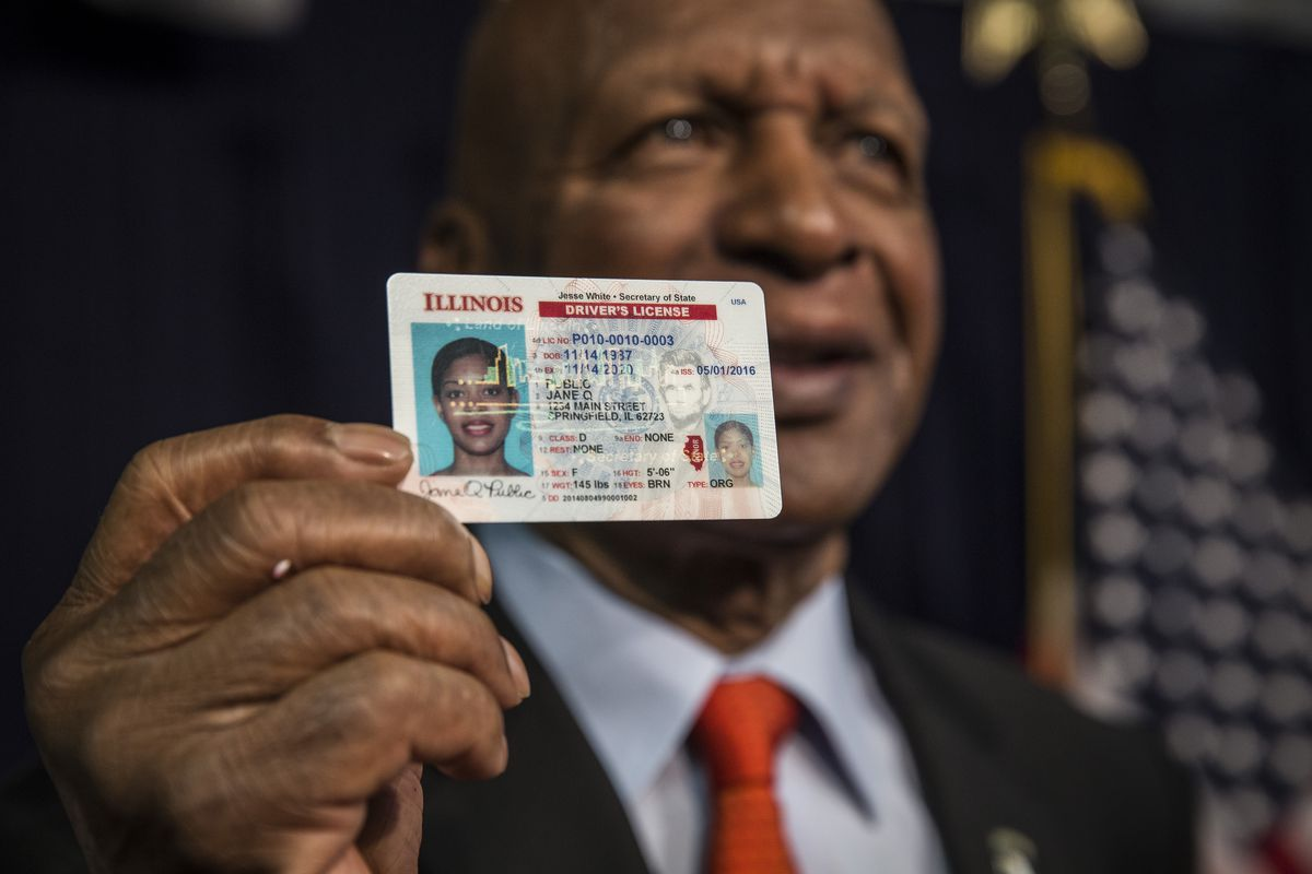 Illinois Secretary of State Jesse White shows a driver's license featuring upgraded security in 2016.