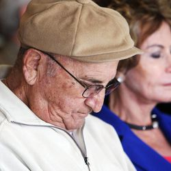 Holocaust survivor Abe Katz participates in a moment of silence during a Utah Holocaust Memorial Commemoration at the Jewish Community Center in Salt Lake City, Thursday, April 19, 2012.
