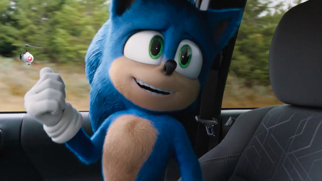 sonic the hedgehog (redesigned) looks at a drone floating outside a car window in Sonic the Hedgehog