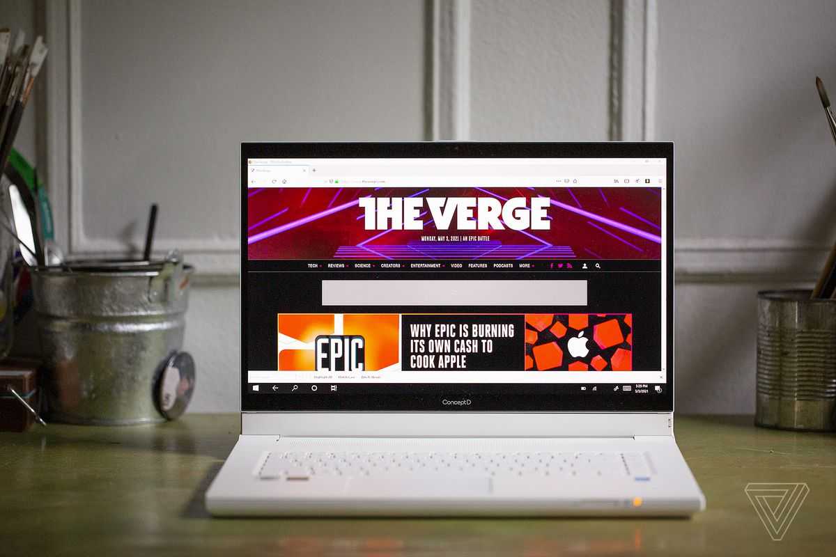 The Acer ConceptD 7 Ezel seen from the front on a desk. The screen displays The Verge homepage.