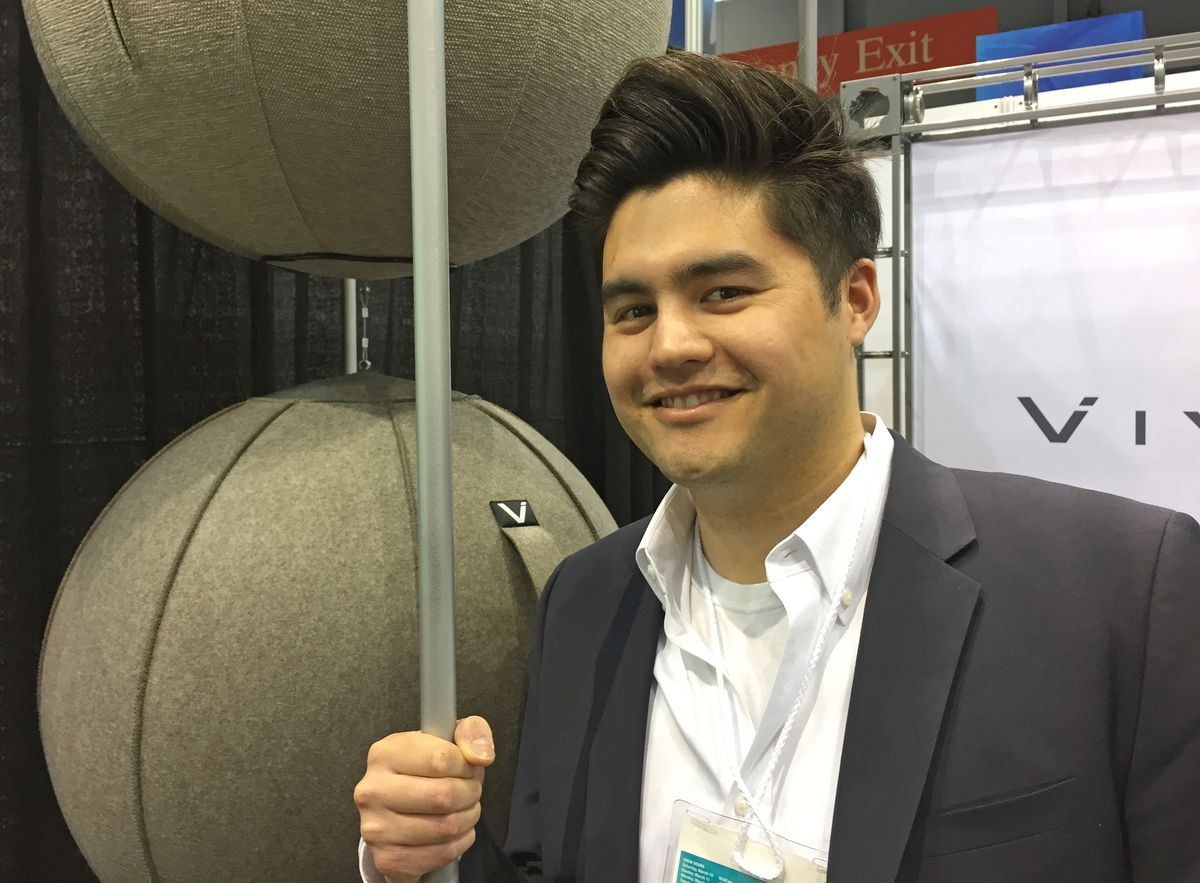 Jimmie Sit, at the 2018 Home + Housewares Show, which ended Tuesday, said he noticed only recently that his last name makes him uniquely suited to promote the elegant inflatable ball chairs sold by Vivora, a Forest Park company.   Neil Steinberg/Sun-Times