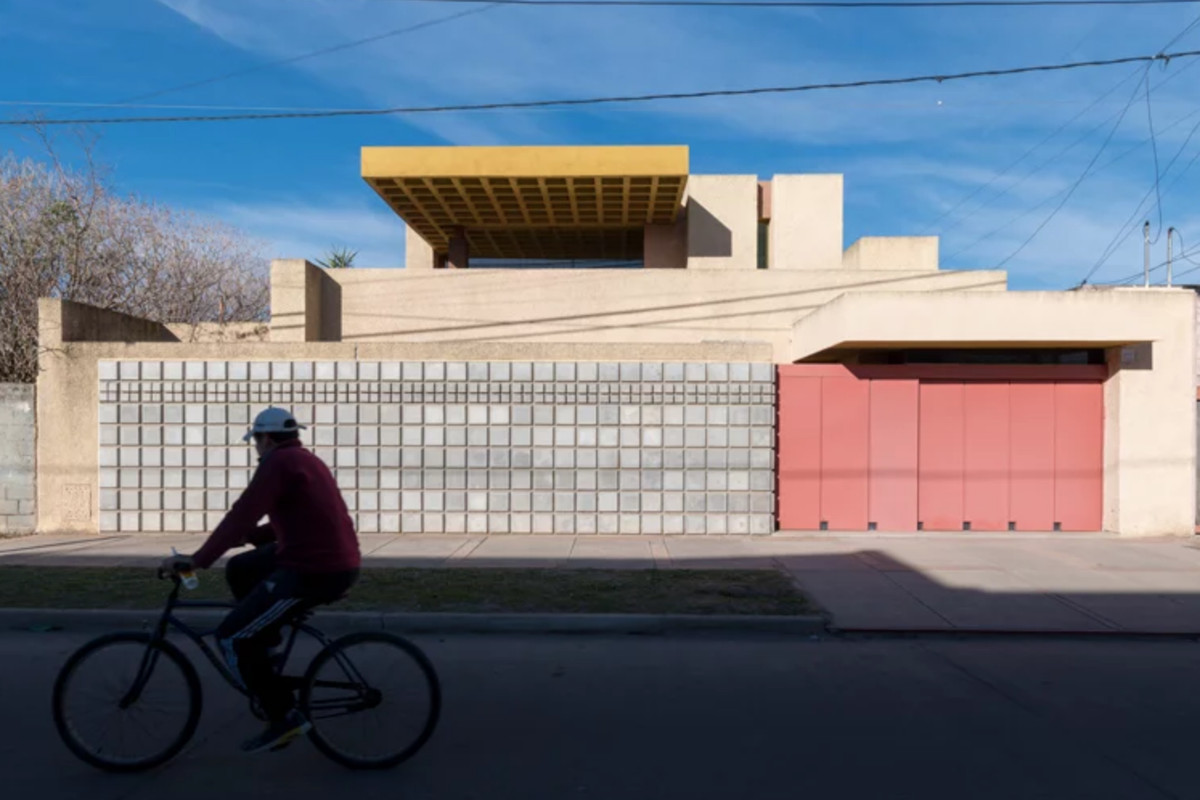 Exterior of house with concrete and pink wall