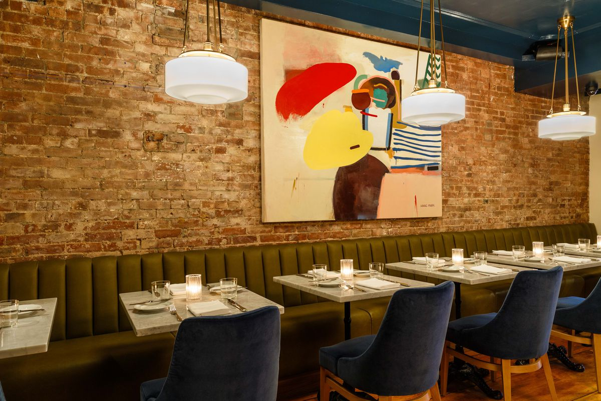 Blue dining chairs, marble tables, green banquets, modernist painting hanging in the back