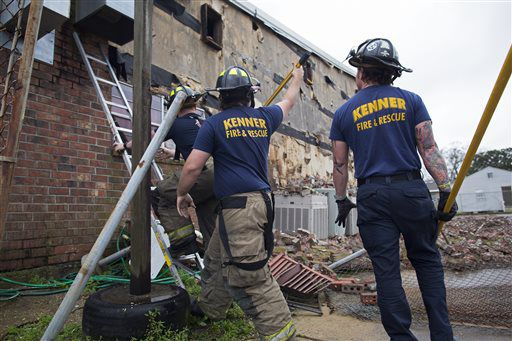 Members of the Kenner Fire Department knock down bricks from the wall of the New Mount Bethel Baptist Church which suffered suffered weather damage Tuesday. | Max Becherer/AP