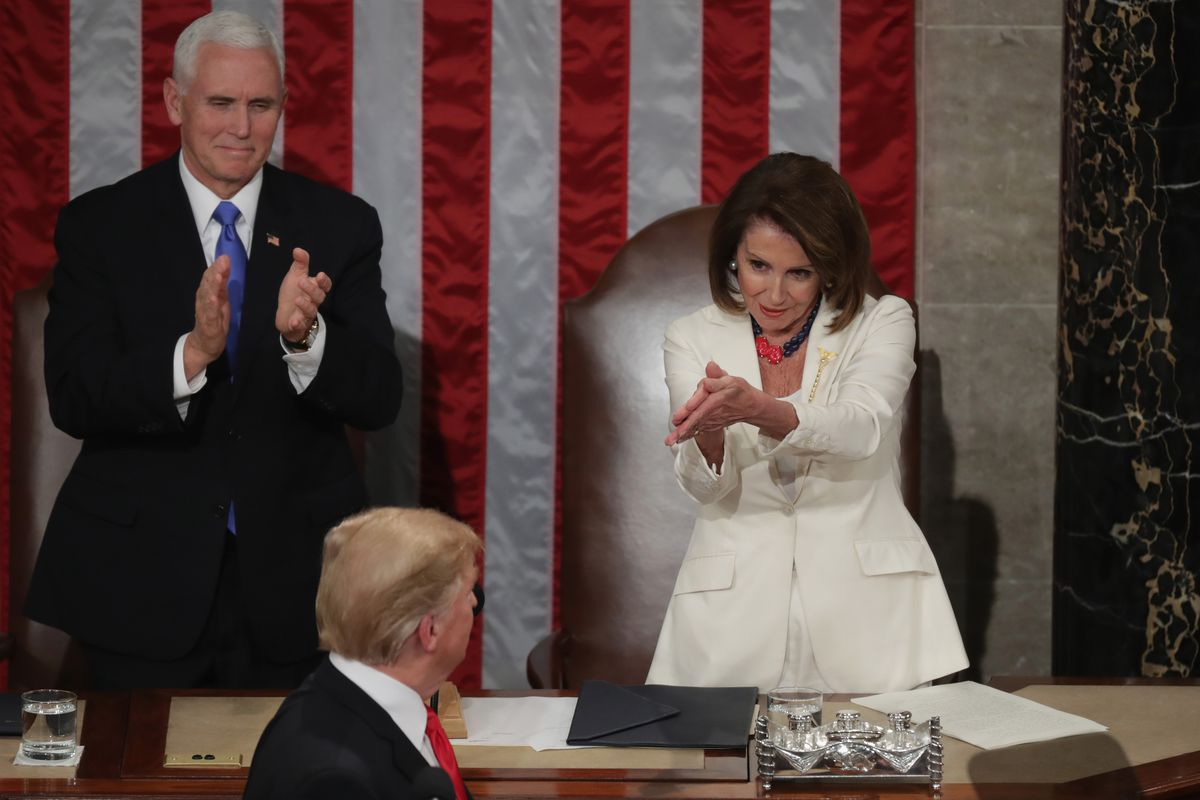 Vice President Mike Pence and House Speaker Nancy Pelosi stand and applaud President Trump at his State of the Union Address.