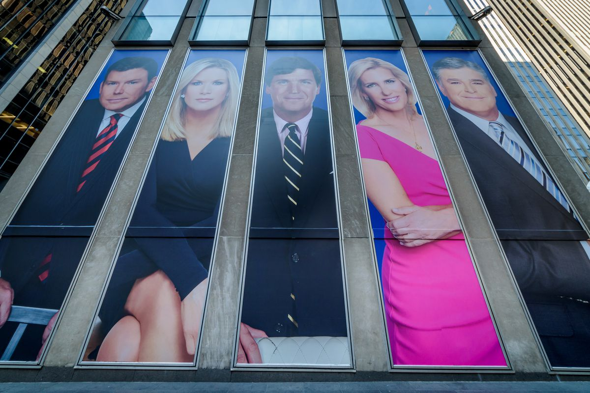 Portraits of Fox News anchors are seen on the outside of the network's headquarters.