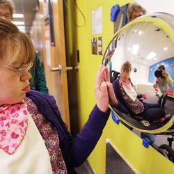 Jordan Valley School student Maura Lloyd looks at a mirror in the Snoezelen Room at the school in Midvale Tuesday, Feb. 19, 2013. Lloyd does not speak and has severe visual and hearing impairments.